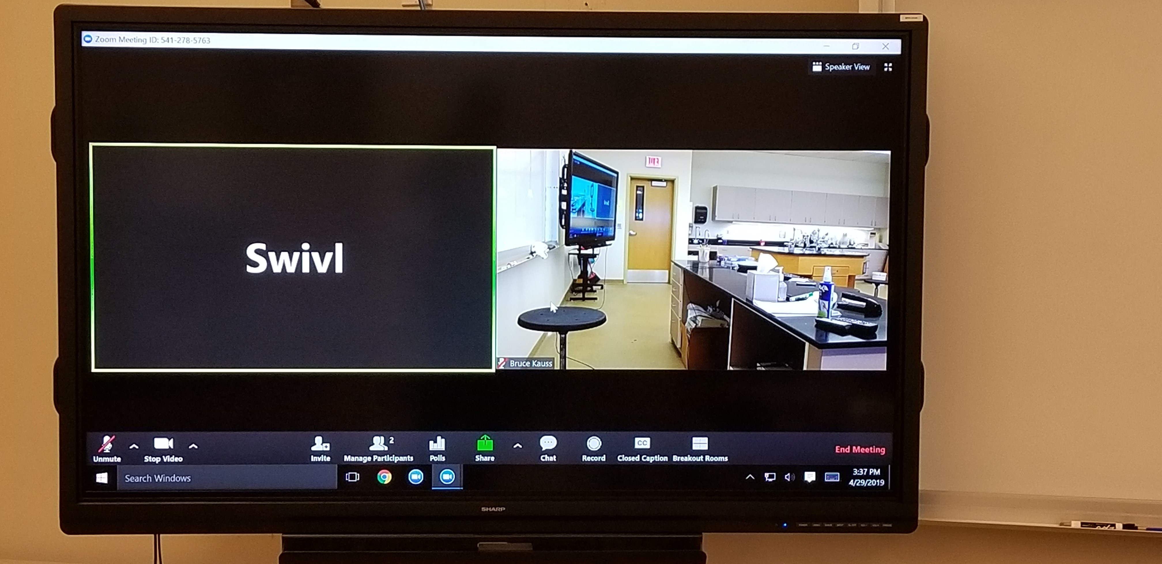 Classroom monitor with Swivl camera and Zoom Meeting displayed.