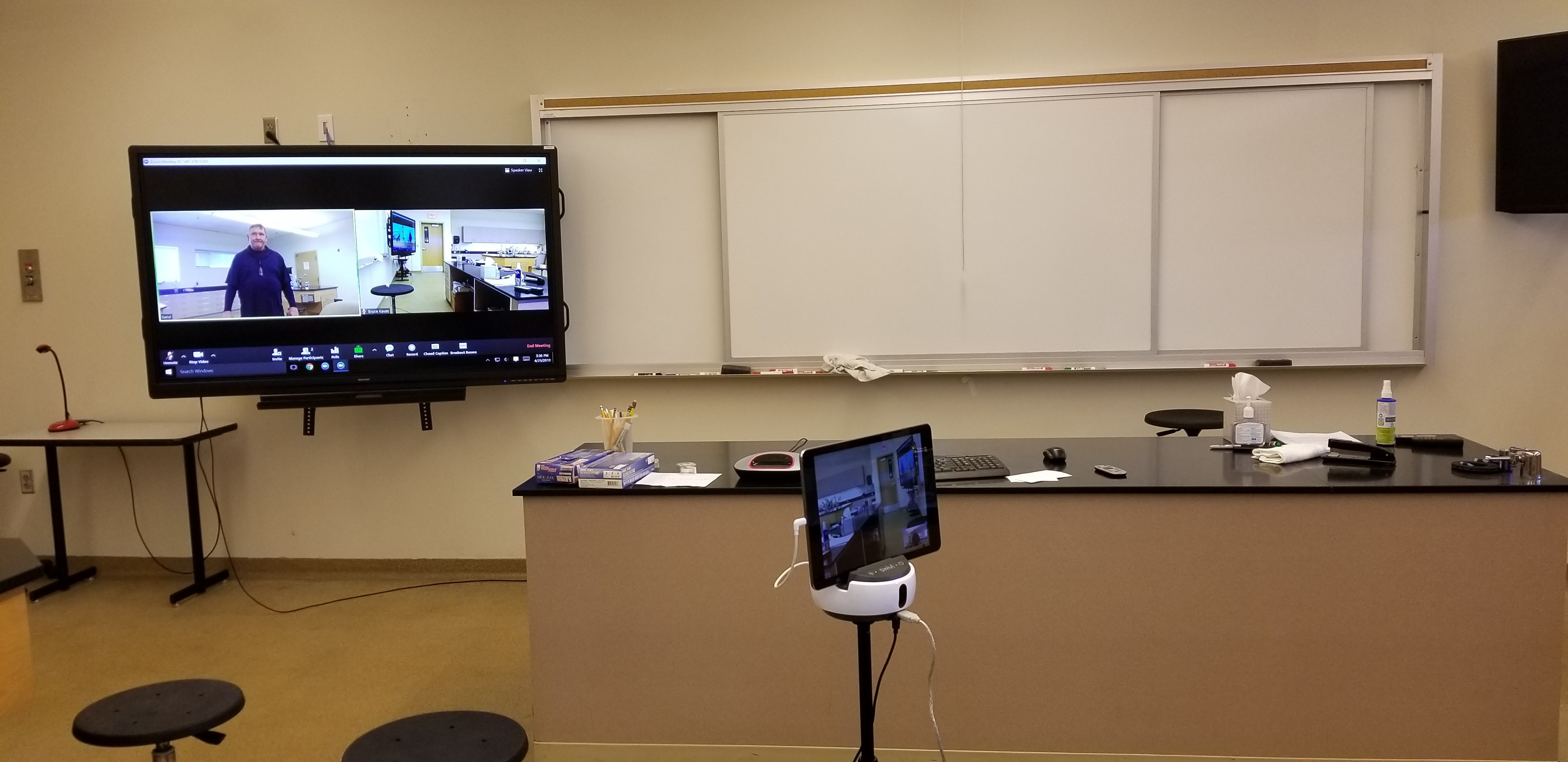 Biology classroom lab showing the Swivl with iPad and classroom display in the background.